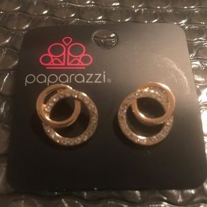 Gold studs with diamonds surround them. Too cute!!